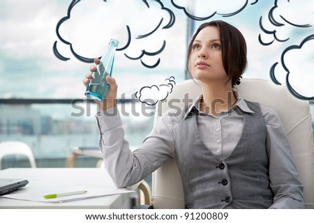 Beautiful business woman thinking about something while drinking cool fresh mineral water at her office. Blank cloud balloon overhead