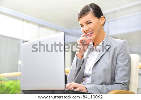 Beautiful business woman thinking about something while working no computer at her office