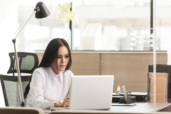 Beautiful business woman using a laptop computer at office