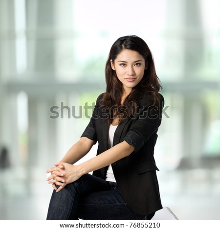 Beautiful business woman with a very relaxed, friendly smile.