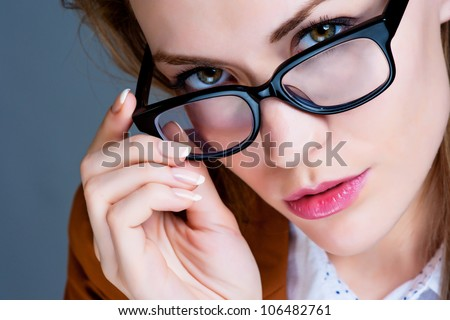 Beautiful business woman with glasses. Close-up portrait