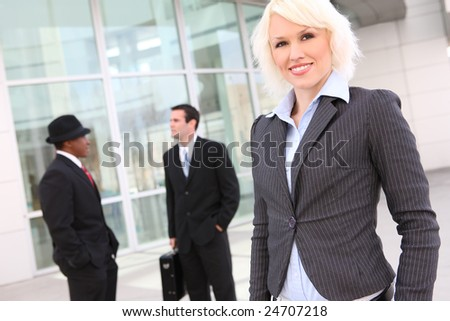 Beautiful business woman with team at the office building