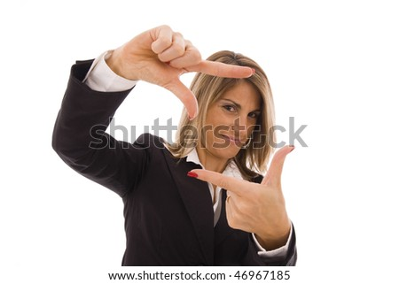 Beautiful businesswoman doing a frame with her hands
