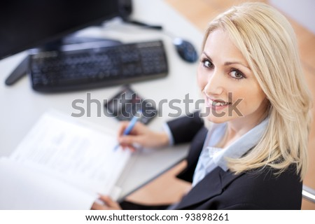 Beautiful businesswoman doing finances in the office