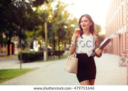 Beautiful businesswoman drinking coffee #479751646