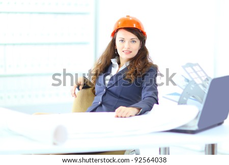 Beautiful businesswoman engineer with the work-plan office.