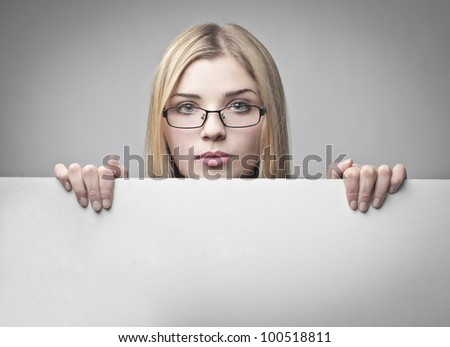 Beautiful businesswoman holding a white billboard