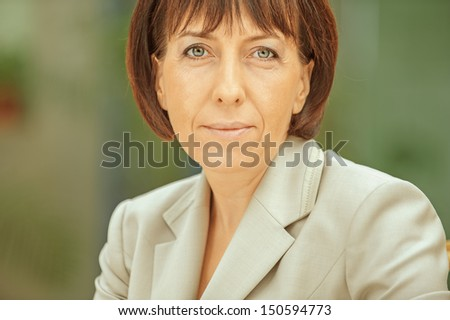 Beautiful businesswoman in bright suit, close-up.