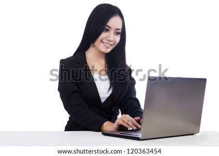 Beautiful businesswoman is working with her laptop, isolated in white