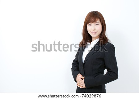 Beautiful businesswoman isolated on white.