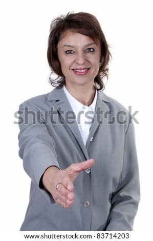 beautiful businesswoman offering hand with a smile