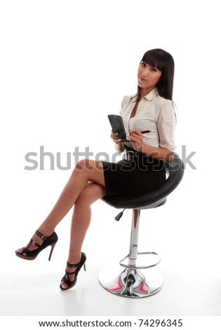 Beautiful businesswoman, office worker, stenographer, wearing office attire, sitting down with notepad and pen.  White background.