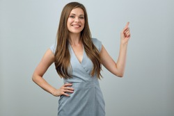 Beautiful businesswoman pointing finger. Isolated portrait of happy smiling woman.