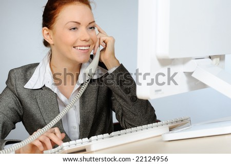 Beautiful businesswoman smiling while talking on telephone