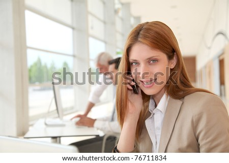 Beautiful businesswoman talking on the phone