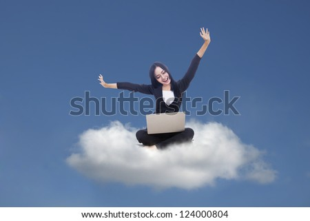 Beautiful businesswoman touch something on copy space over grey background - stock photo