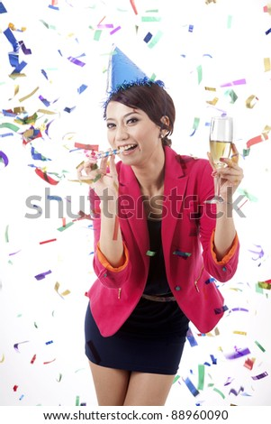 Beautiful businesswoman with champagne in confetti isolated on white