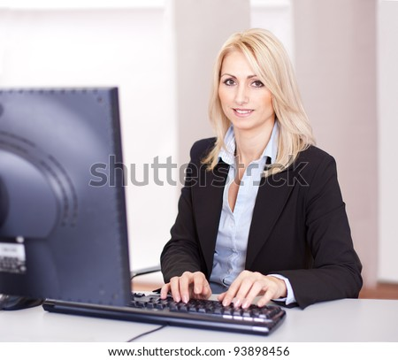 Beautiful businesswoman working on computer in the office