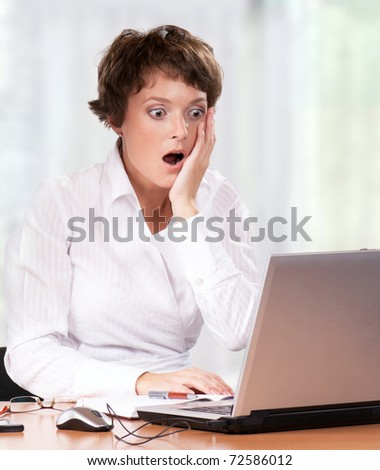 Beautiful  businesswoman working with laptop at her office
