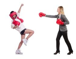 Beautiful businesswomen boxing isolated on white
