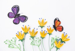 beautiful butterflies and yellow flowers, isolated on white background. Hand made of paper quilling technique.