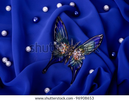Beautiful butterfly on dark blue fabric