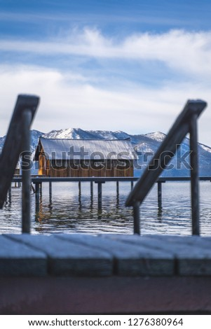 Beautiful cabin along the lake Tahoe water in California nearby the snow capped mountains during a road trip stop driving through San Francisco near Truckee