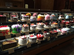 Beautiful cakes on display at a local bakery.