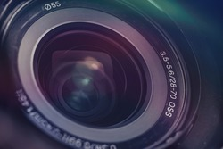Beautiful camera lens with multi colored light of glass. Background pattern for design.
