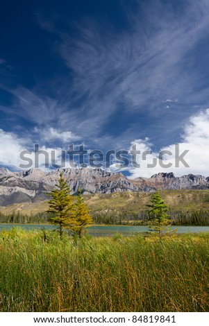 Beautiful Canadian Landscape: Swampy Talbot Lake, Rocky Mountains and Cloudy Sky. Photo is taken on sunny day of autumn in Jasper National Park, Alberta, Canada