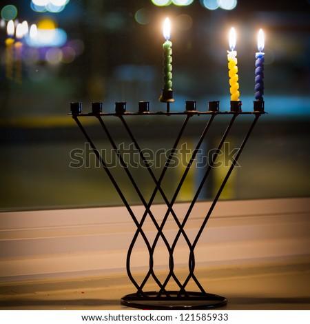 Beautiful candles and hanukkah menorah with defocus background