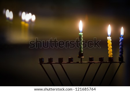 Beautiful candles and hanukkah menorah with defocus background