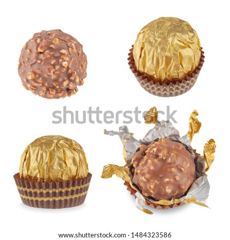 Beautiful candy in the shape of a sphere in a Golden wrapper in a paper skirt, isolated on white with shadows. Full sharpness across the surface. The mix of the four perspectives of candy. Photo stock ©
