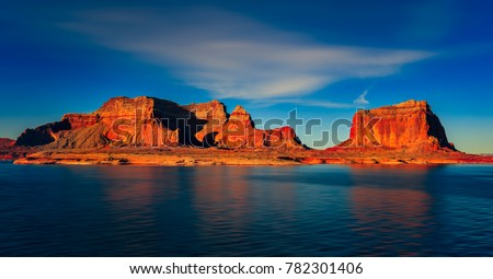 Beautiful canyon and lonely rocks on the Lake Powell, Utah. Lake Powell is based on Colorado River with a great view on the canyoon.