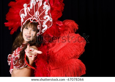Beautiful carnival dancer in red feather costume