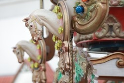 Beautiful carousel with horses figures and sculptures