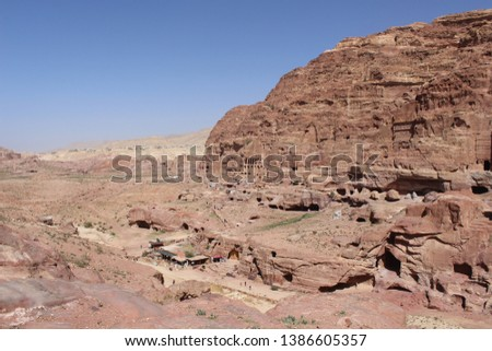 Beautiful carved tomb facades on the Street of Facades in a famous historical and archaeological city of Petra, Wadi Musa, Jordan #1386605357