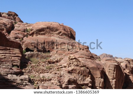 Beautiful carved tomb facades on the Street of Facades in a famous historical and archaeological city of Petra, Wadi Musa, Jordan #1386605369