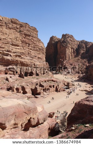 Beautiful carved tomb facades on the Street of Facades in a famous historical and archaeological city of Petra, Wadi Musa, Jordan #1386674984