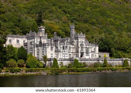 Beautiful Castle At A Lake Beside Mountain