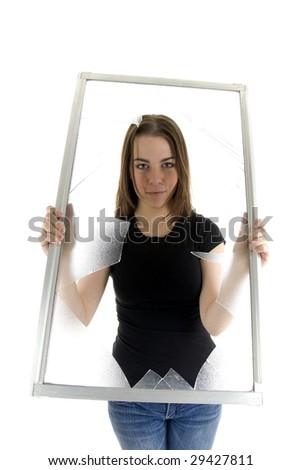 Beautiful casual business woman holding broken window.  Breaking through the glass ceiling