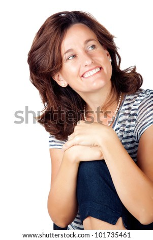 Beautiful casual young woman in her 30s sitting on a chair against white background and wearing top with stripes and jeans
