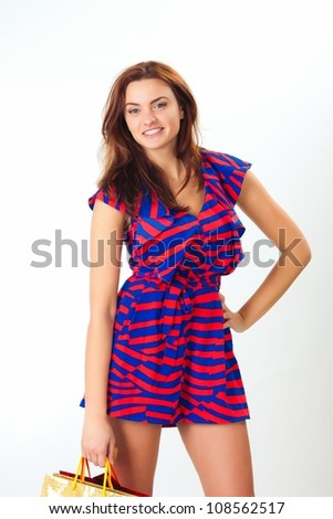 Beautiful casual young woman standing against white background