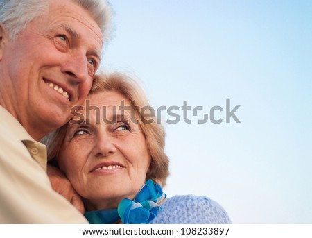 Beautiful Caucasian aged couple in the street