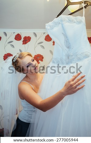 Beautiful caucasian bride getting ready for the wedding ceremony.