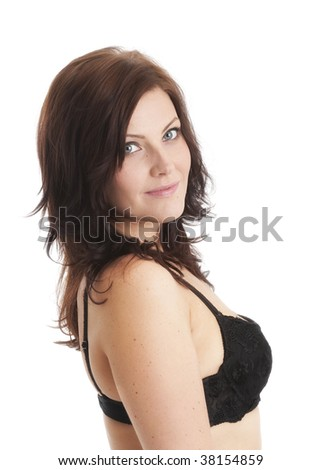 Beautiful Caucasian brunette in black underwear smiling gently over her shoulder - stock photo