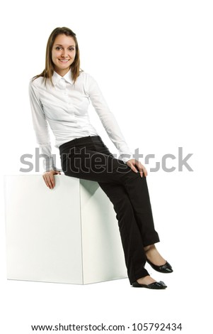 Beautiful caucasian business woman sitting on white block leaning back