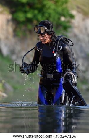 beautiful caucasian diver woman in the water #398247136