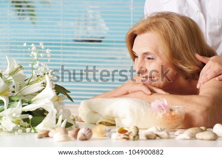 Beautiful Caucasian elderly woman at a reception in the spa salon