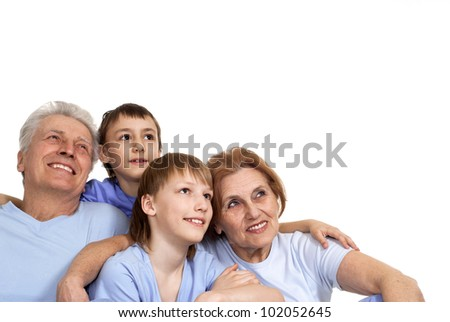 Beautiful Caucasian family of four on a white background